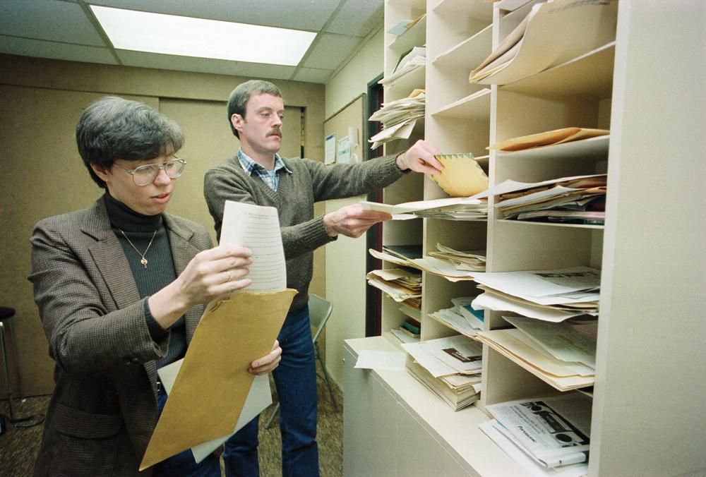 Linda Wilson and John Duggan sorting mail, GO Centre